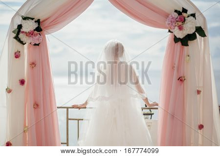 Bride In Wedding Arch Destination