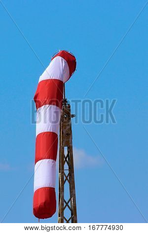 red and white windsock wind blue sky background