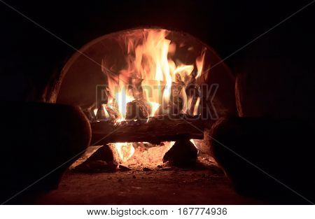 Wood burning in the Russian oven. It is fire.