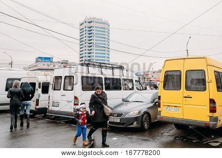 Tbilisi, Georgia - October 24, 2016: Woman And Child Walks Near Urban Taxis Minibuses Are On The Station Didube In Tbilisi, Georgia.
