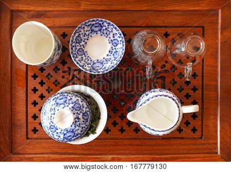 Chinese tea table with tea. Cup and saucer gaiwan. Photo close-up top