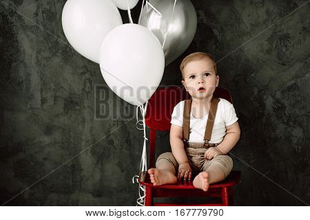 Portrait Of Lovely Little Boy Happy Smiling Celebrating 1 Year Birthday. One Year Old European Littl