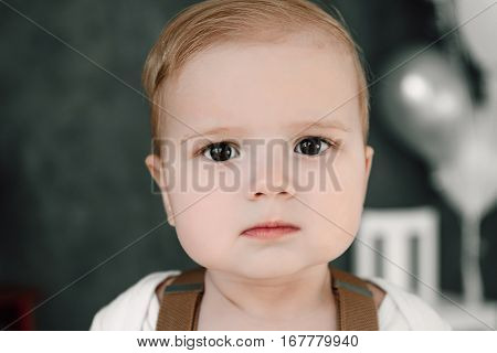 Portrait Of Lovely Little Boy Happy Smiling Celebrating 1 Year Birthday. One Year Old European Boy S