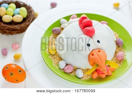 Easter chicken in nest holiday cake decorated fondant chocolate candy eggs and cookies crumbs
