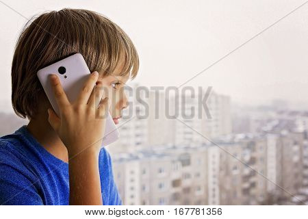 Child talking on mobile phone. People, technology and communication concept.