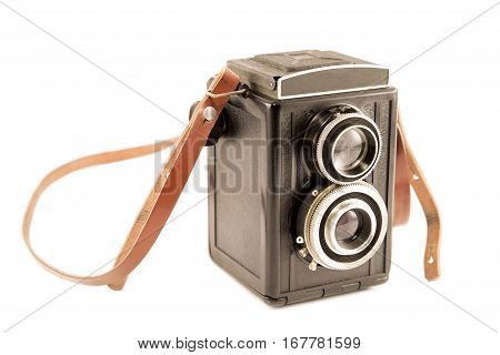 Old camera with the leather strap isolated