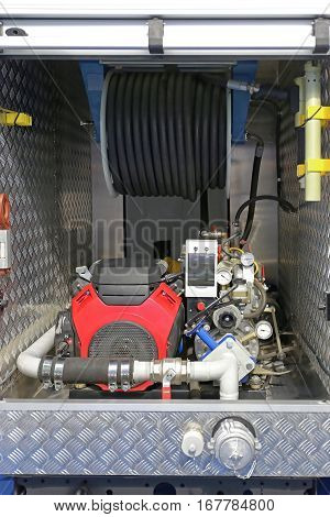 Water Pump and Hose in Fire Engine Truck