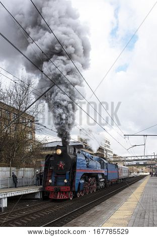 The blue retro steam locomotive. To start moving