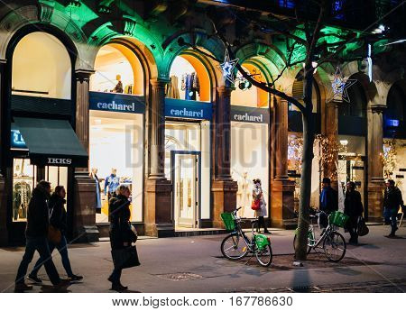 STRASBOURG FRANCE - DEC 20 2016: Cacharel pret-a-porter fashion store in central Strasbourg on the shopping street with people walking and admiring the sales facades during winter holidays