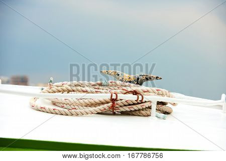 Detail of rope on a passenger taxi boat in the port of Athens Greece with water in the background