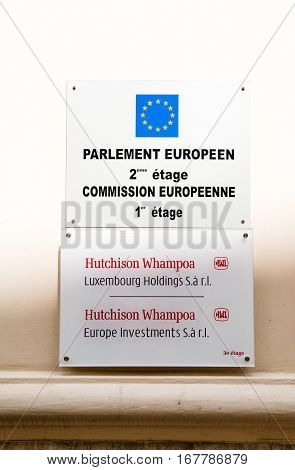 LUXEMBOURG LUXEMBOURG - JUN 15 2016: Hutchinson Whampoa Luxembourg Holdings and Investments under European Parliament and European Comission sign on the facade of their offices in Luxembourg