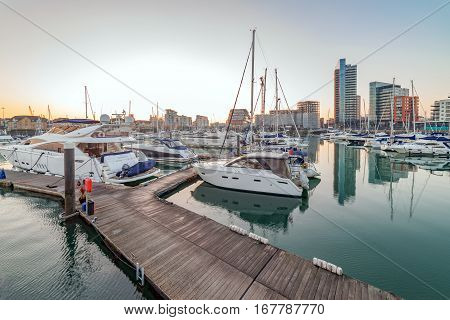 Southampton, UK. 22nd January 2017. Boats are moored up at Ocean Village Marina against the backdrop of luxury apartments and retail facilities