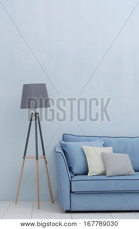 Modern couch and lamp on light wall background