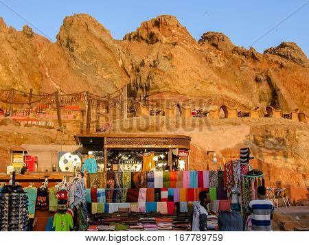 Sharm El-Sheikh, Egypt - October 1, 2007: stand of Egyptian traditional clothes in Old Market at sunset, tourist attraction in Old Sharm. Sharm is a popular for Sinai desert and Red Sea coral reef.