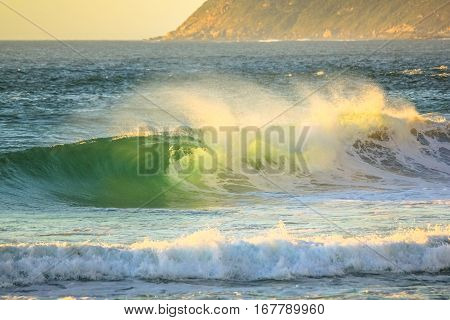 Big waves in Noordhoek Beach. Surfing in Cape Town, South Africa. Atlantic coast, Table Mountain National Park. Extreme sports leisure concept. Powerful waves background.