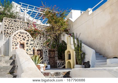 Thira Greece - November 10 2015: One of the traditional houses on the greek island Santorini in the southern Aegean Sea with its cycladic architectural elements made of local volcanic stone (pumice) and whitewashed.