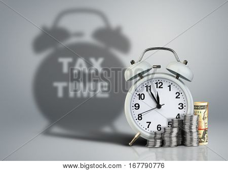 Clock with money and tax time shadow financial concept