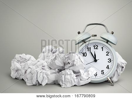 Clock and clumpled peper waste of time concept