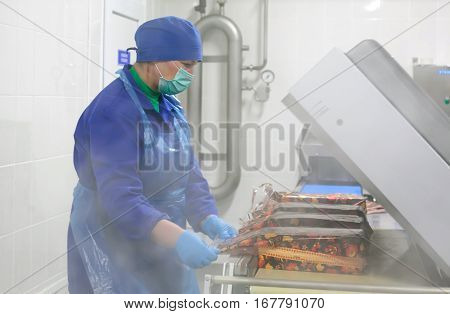 SHUCHIN BELARUS - JANUARY 26 2015.The woman is engaged in the packaging of cheese on a cheese factory.