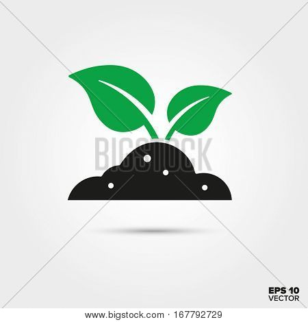 Green sprout in Black Soil Icon. Environment, Nature and Reforestation Symbol. EPS 10 Vector.