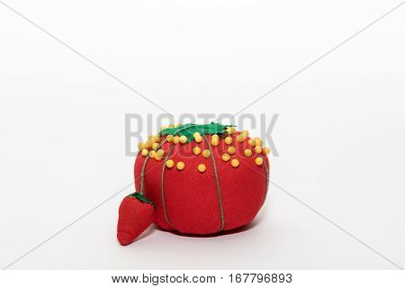 Closeup of a red tomato sewing pin cushion