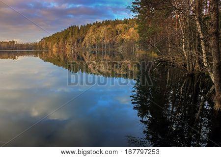Hawk lake at sunset , Karelian isthmus, Russia