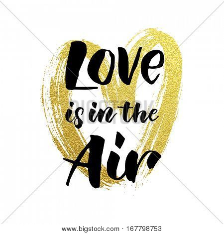 Gold glitter heart and Love is in the air text vector Valentines day greeting card with black calligraphy text on white background.