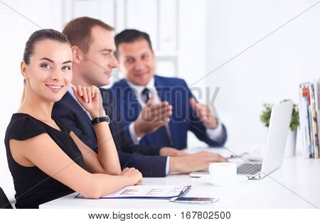 Business people sitting and discussing at meeting