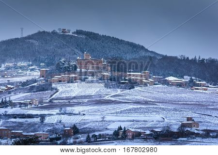 Snowed Landscape Of Beaujolais With Vineyards And Montmelas Castle, France