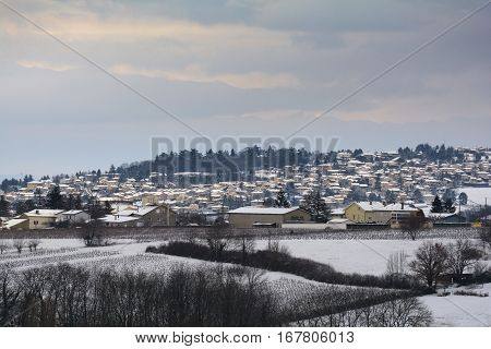 Snowed Landscape And Village Of Beaujolais, France