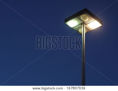 street lamp electric economy renewable power light on blue sky