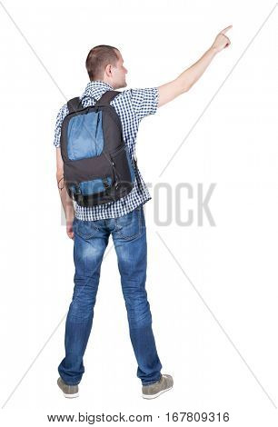 Back view of  pointing man Back view of man with photographic backpack pointing. Standing young guy. Rear view people collection.  backside view of person. Isolated over white background.
