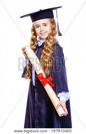 Portrait of a cute nine year old girl in an academic gown and hat holding a diploma. Educational concept. Isolated over white.