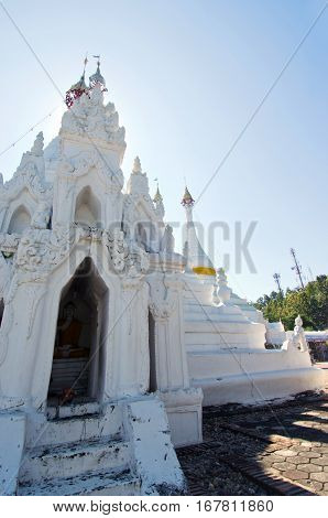 White buddha pagoda temple in Wat Pra Tard Doi Kong Mu temple with clear blue sky in Mae Hong Son province Thailand