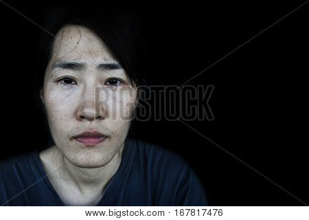 depressed and hopless woman with tear on black