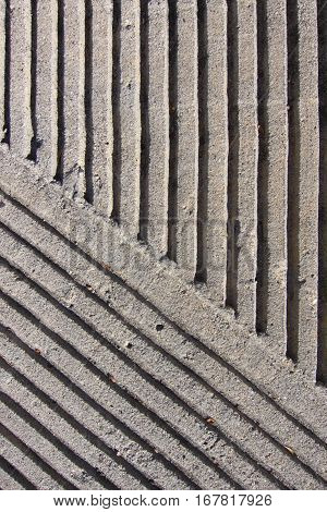 Grooved cement sidewalk safety pattern, close up