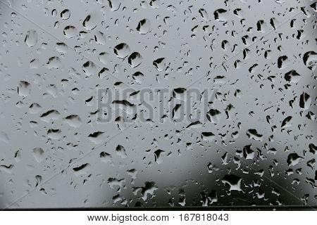Rain drops adhering to window, sky overcast, closeup