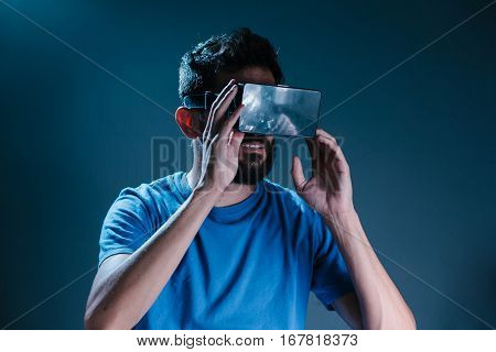Excited Man Experiencing Virtual Reality Via Vr Headset