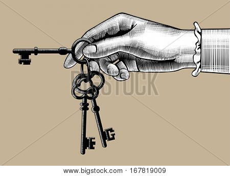 Woman's hand with old keys. Retro style unlock sign and icon. Vintage engraving stylized drawing. Vector illustration