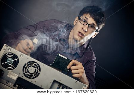 Photo of nerd with smoke coming out of his pc