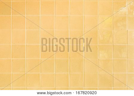 close up background and texture of stretch marks cracked on yellow glazed tile