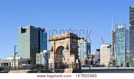 BRISBANE, AUSTRALIA - January 28, 2017: View of the 19th century pedestrian arch over the 21st century modern city of Brisbane Australia