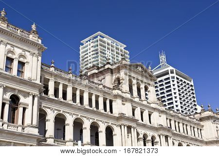 BRISBANE, AUSTRALIA - January 28, 2017: The south facade of the Treasury Building surrounded by modern buildings in Brisbane Australia
