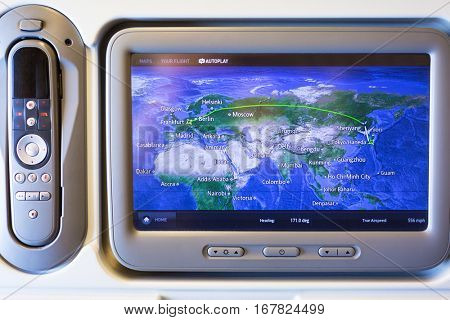 TOKYO, JAPAN - NOVEMBER 6, 2016: Multimedia system with navigation map of Boeing 777 during a flight from Frankfurt to Tokyo, Japan. Boeing 777 is a long range  jet airliners manufactured in USA.