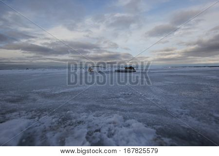 Frozen shallow freshwater Lake Michigan in winter