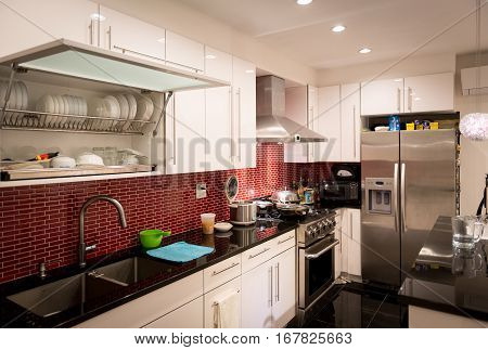Modern designed kitchen with electrics and appliances.