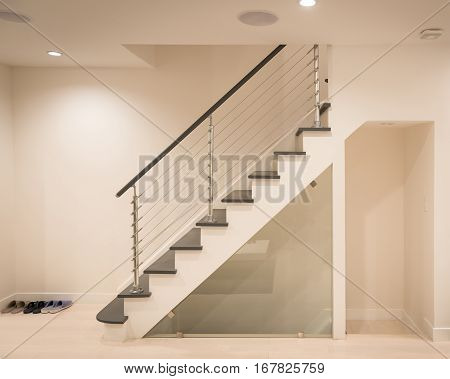 Modern staircase and hand rail design in white and grey color