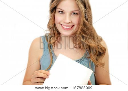 Young smiling woman shows a white paper between her hands on white background