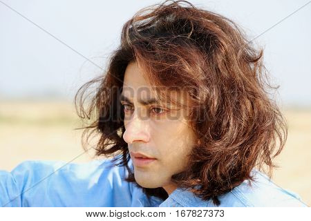 Passions Instinct attractive male model looking, eyes expression, long hair indian, handsome