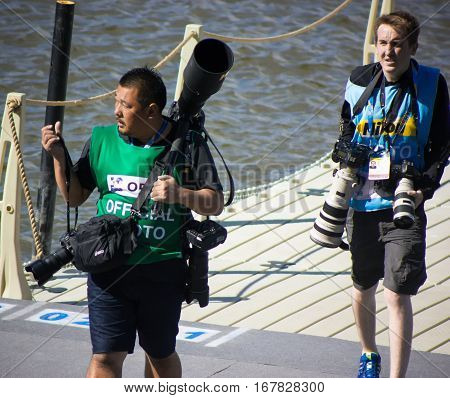 Kazan, Russia, 3 august 2015, FINA - High diving competition: sport photographers carries a lot of equipment, telephoto